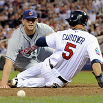 Cleveland Indians' pitcher Justin Masterson looks at the loose ball as Minnesota Twins Michael Cuddyer scores from third on Masterson's wild pitch in the third inning of a baseball game Tues …