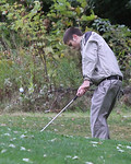 29sep09 bishop--- GOLF Colin Coughlin of Elyria Catholic takes a shot from the wet grass during the Div. II Sectional at Forest Hills Golf Course.