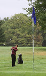 29sep09 bishop--- GOLF Anthony Cwalina watches as chips a shot towards the pin during the Div. II Sectional at Forest Hills Golf Course.