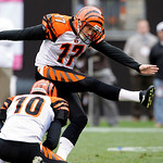 Cincinnati Bengals kicker Shayne Graham (17) kicks a 33-yard field goal in overtime to beat the Cleveland Browns 23-20 in an NFL football game Sunday, Oct. 4, 2009, in Cleveland. Holding is …