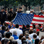 The World Trade Center Flag is presented as friends and relatives of the victims of the 9/11 terrorist attacks gather at the National September 11 Memorial at the World Trade Center site Wed …
