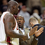 Cleveland Cavaliers head coach Mike Brown, right, talks with Shaquille O'Neal in the first quarter of a preseason NBA basketball game against the Charlotte Bobcats, Tuesday, Oct. 6, 2009, in …