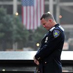 Daniel Henry, a Port Authority of New York/New Jersey police officer, pauses during a moment of silence at 9:01 a.m. at the south reflecting pool at the 9/11 Memorial on Wednesday during cer …