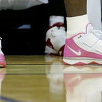 Cleveland Cavaliers' LeBron James wears a pink pair of his signature Nike shoes in observance of breast cancer awareness month in the second quarter of a preseason NBA basketball game agains …