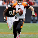 Cincinnati Bengals quarterback Carson Palmer runs for a first down in overtime against the Cleveland Browns during an NFL football game Sunday, Oct. 4, 2009, in Cleveland. The Bengals beat t …