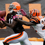Cleveland Browns wide receiver Mohamed Massaquoi catches a 30-yard pass against Cincinnati Bengals cornerback Johnathan Joseph in the second quarter of an NFL football game Sunday, Oct. 4, 2 …