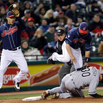 Chicago White Sox's Mark Kotsay (30) upends Cleveland Indians third baseman Jhonny Peralta as Indians' shortstop Niuman Romero, left, takes the throw in the fourth inning of the second game  …