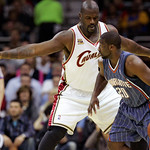 Cleveland Cavaliers' Shaquille O'Neal, left, plays defense against Charlotte Bobcats' Raymond Felton in the first quarter of a preseason NBA basketball game, Tuesday, Oct. 6, 2009, in Clevel …