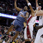 Charlotte Bobcats forward Stephen Graham, left to right, shoots over Cleveland Cavaliers' Jamario Moon in the second quarter of an NBA preseason basketball game, Tuesday, Oct. 6, 2009, in Cl …