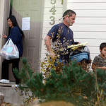 Richard Heene, center, follows his son, Falcon, right, as Mayumi Heene blocks the door as they leave their home in Fort Collins,, Colo., early on Sunday, Oct. 18, 2009. (AP Photo/David Zalub …