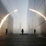 "A visitor walks through the ""Empty Sky"" memorial to New Jersey's victims of the Sept. 11, 2001 terrorist attacks on Wednesday in Jersey City, N.J. One World Trade Center is visible across th …"