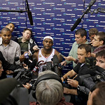 Cleveland Cavaliers' LeBron James, center, answers questions during NBA basketball team's media day Monday, Sept. 28, 2009, in Independence, Ohio. (AP Photo/Tony Dejak)