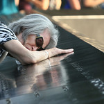 Mija Quigley, of Princeton Junction, N.J., embraces the name of her son, Patrick Quigley, during ceremonies marking the 12th anniversary of the 9/11 attacks on the World Trade Center in New  …