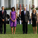 President Barack Obama, first lady Michelle Obama, Vice President Joe Biden, and Jill Biden bow their heads for a moment of silence on the South Lawn of the White House in Washington, Wednes …