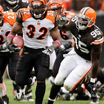 Cincinnati Bengals running back Cedric Benson (32) runs past Cleveland Browns linebacker Kamerion Wimbley (95) in the fourth quarter of an NFL football game Sunday, Oct. 4, 2009, in Clevelan …