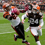 Cincinnati Bengals wide receiver Chad Ochocinco, left, catches a five-yard touchdown pass in front of Cleveland Browns cornerback Eric Wright (24) in the first quarter of an NFL football gam …