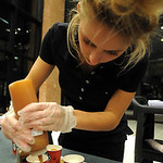 Hayley Manuel of Starbucks at LCCC drizzles caramel onto Caramel CinnaBun Misto! drinks at the 11th annual Zero-Proof Mix-Off at LCCC on Dec. 6.  Steve Manheim