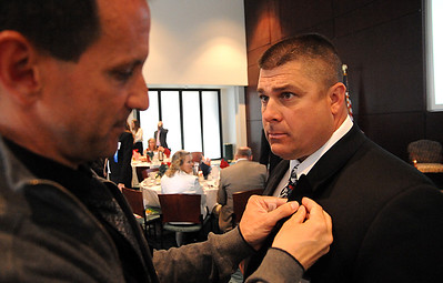 Ken Fenik has his pin put on by Jerry Chizmar at the Elyria Sports Hall of Fame induction banquet at LCCC on May 4.    Steve Manheim