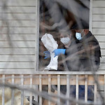 Investigators looks for possible evidence on the second floor balcony of the home of Anthony Sowell Wednesday, Nov. 18, 2009, in Cleveland. Investigators looking into the discovery of 10 bod …