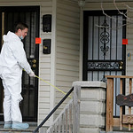 An investigator measures the front porch at the home of Anthony Sowell Wednesday, Nov. 18, 2009, in Cleveland. Investigators looking into the discovery of 10 bodies and a skull at the home o …
