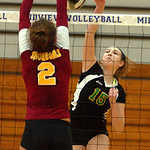 Amherst Morgan Dziak hits over Avon Lake Whitney Craigo in sectional final Oct. 27.  Steve Manheim