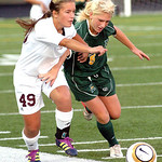 Avon Lake's #49 Natalie Quintero fights Amherst's #5 Emily Varouh for the ball.