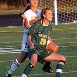 Avon Lake's #11 Emily Peterson and Amherst's #26 Ally Perkins try to head the ball.