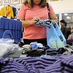 Marian Borckway of Vermilion picks out clothes at the Kid's Kloset resale event by the Avon Early Chioldhood PTA at Avon High Sep. 25.  Steve Manheim