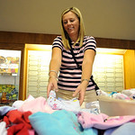 Avon com/  Traci Fillmore, of Avon, sets out chldren's clothes for sale at the Avon Early Childhood PTA's annual Kloset resale event at Avon High School Sep. 25.  Over 60 tables and 750 peop …