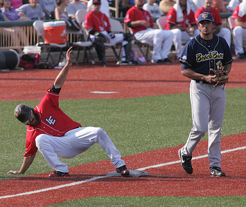 26AUG12   Andrew Davis has trouble holding third base; Beach Bum is Jose Vargas.   photo by Chuck Humel