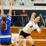 EC Catherine O'Shaughnessy hits past Bay' Megan Lowery Oct. 9.    Steve Manheim