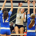EC 5 Abbey Flowers hits past Bay 12 Makenna Coyle and Megan Lowery on Oct. 9.  Steve Manheim