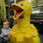10NOV09  Six month old Madison Norton, held by her mom Amanda, was amazed at how soft Sesame Street's Big Bird's 'feathers' were.  Big Bird visited the Wellington Fire Department to safely l …