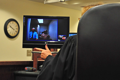 Brady Phillips is arraigned Tuesday via video from the county jail in Judge Lisa Locke Graves' courtroom at the Elyria Municipal Court. (Photo by Rona Proudfoot.)