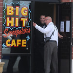 Elyria police Capt. Chris Constantino talks to an officer at the door of the Big Hit Sweepstakes Cafe where they were investigating an armed robbery that occurred Monday afternoon.