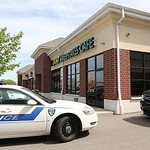 Elyria police vehicles sit outside the Big Hit Sweepstakes Cafe in Chestnut Commons following an armed robbery.