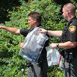 Lorain County Sheriff's deputies search for evidence after an arrest on July 14. STEVE MANHEIM/CHRONICLE