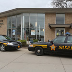 Sheriff's cruisers sit outside the Lorain National Bank on state Route 254 in Sheffield Township.