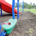 Skid marks on right, where a car hit the playground and crashed into the wall at The Boys and Girls Clubs of Lorain County in Elyria on July 24.  Steve Manheim