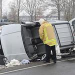 Oberlin fire chief looks over car involved in MVA at Oberlin Rd and Butternut Ridge Rd. Feb. 14.   Steve Manheim