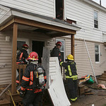 Lorain firefighters wrap up their work at a fire scene in Lorain that took out six apartments.