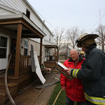 A representitive of the Red Cross gets an update from the Lorain Fire Department on the number of residents who will be needing help after a fire damaged six apartments out on East 29th Stre …