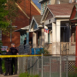Cleveland Police stand outside a home where they say missing women, Amanda Berry, Gina DeJesus and Michele Knight were found in the 2200 block of Seymour Avenue in Cleveland on Monday, May 6 …