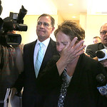 A crying Nancy Smith is led to an elevator by her attorney, Jack Bradley, as she leaves the court for the last time. Smith took a plea agreement that ends her possibility of returning to pri …