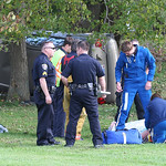 North Ridgeville rescue workers and Lifeflight crew get the victim of a single car accident ready to fly. His car from the acccident on Center Ridge Rd. in North Ridgeville is on its side ne …