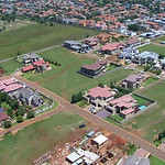 This aerial image taken from video provided by VNS24/7 on Thursday Feb. 14, 2013, shows the gated housing complex with the home of Olympic athlete Oscar Pistorius in Pretoria, South Africa.  …