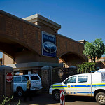 A police vehicle enters the housing estate where Olympian Oscar Pistorius lives, in Pretoria, South Africa, Thursday, Feb. 14, 2013. Reports say that a 30-year-old woman was shot dead at Pis …