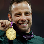 FILE – In this Saturday, Sept. 8, 2012, file photo, Gold medalist South Africa's Oscar Pistorius poses with his medal during the ceremony after winning the men's 400 meters T44 category fina …