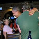 President Barack Obama talks with patrons as he stops for a beer at Ziggy's Pub and Restaurant in Amherst, Ohio, Thursday, July 5, 2012. Obama is on a two-day bus trip through Ohio and Penns …