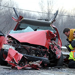 North Ridgeville firefighters look over damage in a car which hit a truck on Rt. 83.   Steve Manheim